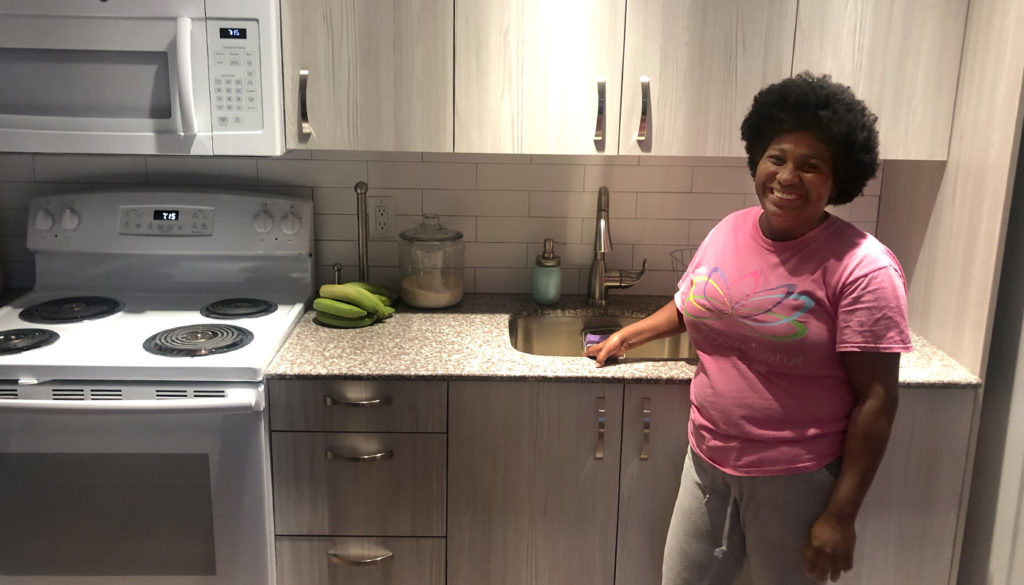 Happy resident in her new kitchen at 16 Corner